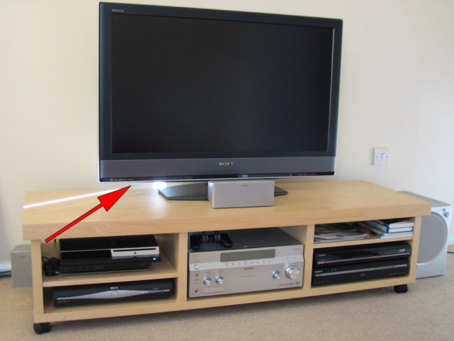 The USB port on the back of most TVs can be used to charge your phone if you're traveling.