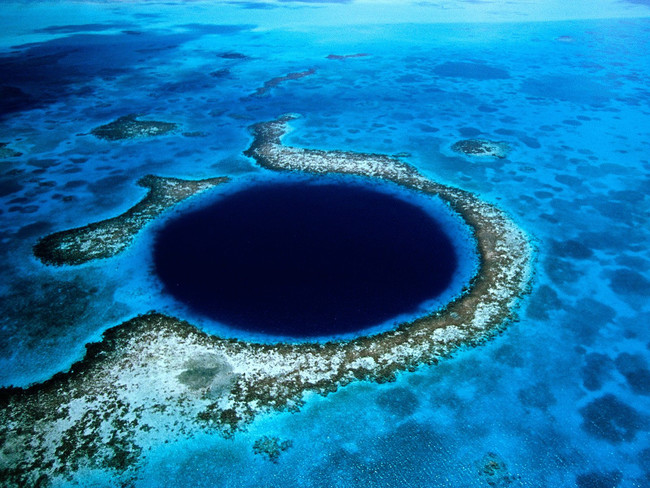 Go below the surface in Belize's Great Blue Hole.