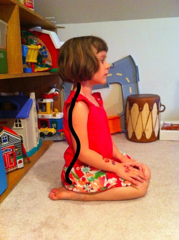 And here's what happens when little ones tuck their legs under their bums instead. While they'll still have to reach down to play with their toys, the position helps stabilize and support the lumbar regions of their backs.